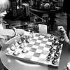 Kids Playing Chess in Store in Newport Beach California black and white