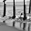 Playing Under Balboa Pier at Newport Beach CA black and white