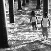 Under the Newport Beach Pier in CA black and white